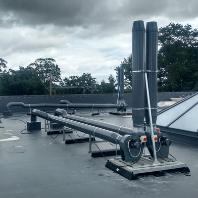 Roof installation of plastic extract fans and ductwork for fume cupboards