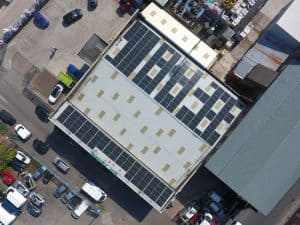going green, solar panels, factory roof